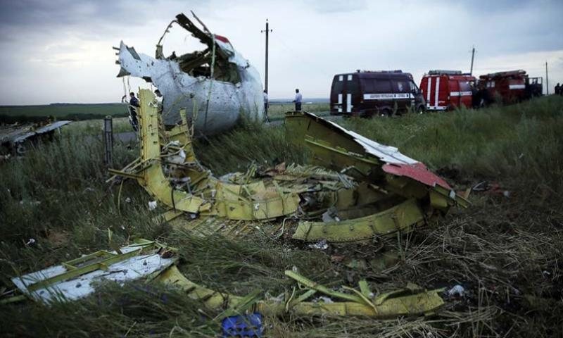Debris from the crashed Malaysia Airlines Flight 17 is seen in eastern Ukraine on Thursday, July 17, 2014. The jetliner was en route from Amsterdam to Kuala Lumpur. ZURAB DZHAVAKHADZE/ITAR-TASS/ZUMA PRESS/MCT