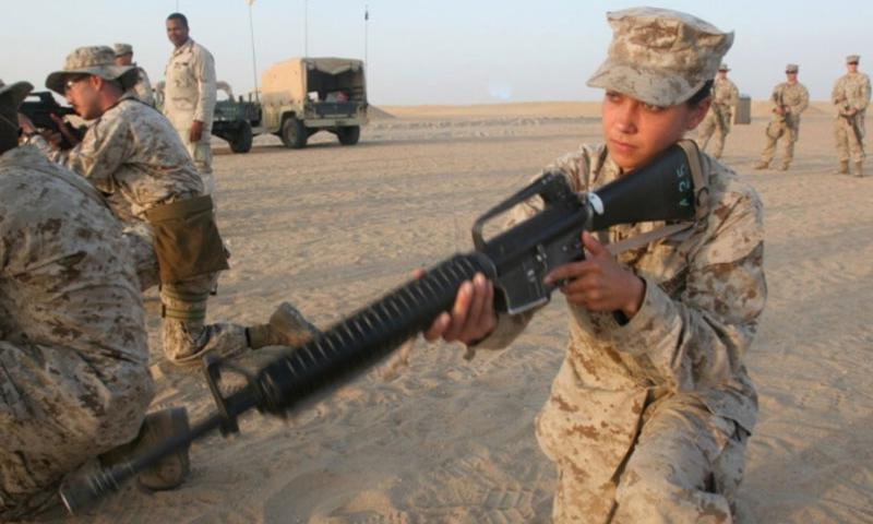 Former U.S. Marine Cpl. Laura Buckingham, then a field radio operator with the 22nd Marine Expeditionary Unit (Special Operations Capable) communications section, practices engaging targets while kneeling at a remote shooting range outside Camp Buehring, Kuwait in September 2007. Buckingham has been charged with criminal intent to commit first-degree murder in a foiled plot to kill her ex-fiancee earlier this year.     U.S. Marine Corps photo