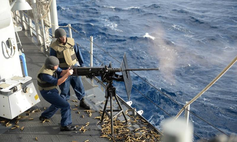 Petty Officer 1st Class Lee Harstad, assigned to the Ticonderoga-class guided-missile cruiser USS Antietam, fires a .50 caliber automatic machine gun during Talisman Saber 2013.  Declan Barnes/U.S. Navy