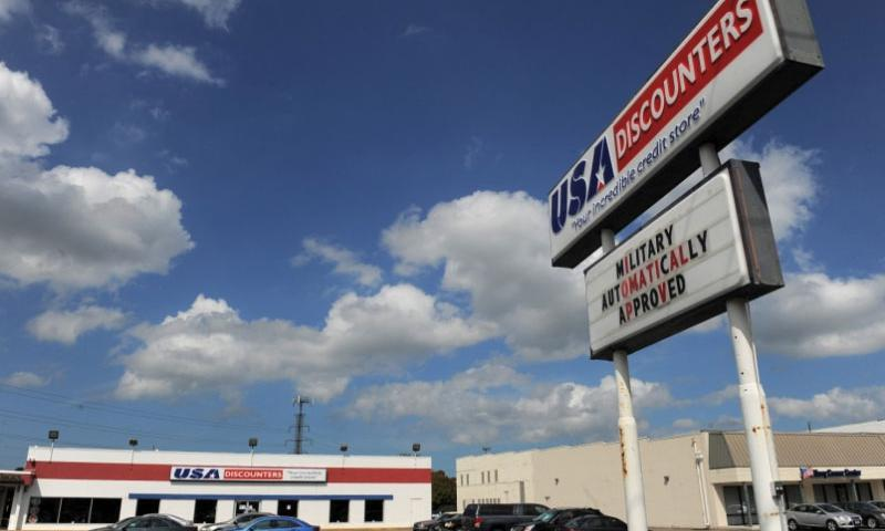 A location of USA Discounters is seen on June 24, 2014, in Norfolk, Va.  Matt McClain/The Washington Post