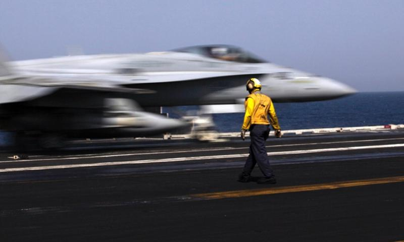 A U.S. F/A-18 fighter jet takes off for Iraq from the flight deck of the U.S. Navy aircraft carrier USS George H.W. Bush, in the Persian Gulf, on Aug. 11, 2014. U.S. military officials said Tuesday, Sept. 9, 2014, that aircraft were launched overnight Monday into Tuesday morning targeting Islamic State vehicles.  AP