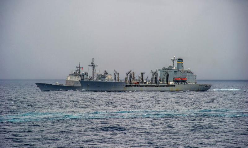 The guided missile cruiser USS Antietam (CG 54), background, steams alongside the fleet replenishment oiler USNS Walter S. Diehl (T-AO 193) during a replenishment at sea in the South China Sea June 23, 2014.   Chris Cavagnaro/U.S. Navy