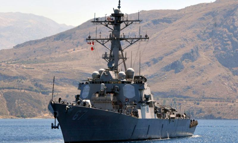 The guided missile destroyer USS Cole conducts a berth shift during a port visit on the Greek island of Crete in June 2012. (Paul Farley/U.S. Navy)