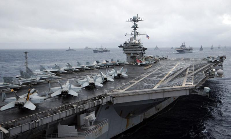 U.S. and Japanese ships steam in formation behind the USS George Washington in this file photo. Adam K. Thomas/Courtesy U.S. Navy