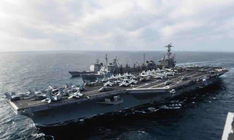 The USS John C. Stennis participates in a replenishment in the South China Sea with the USNS Rainier and the guided-missile cruiser USS Mobile Bay, March 4, 2016. Freedom of navigation in Asia-Pacific waters has limits, China's foreign minister said Tuesday, March 8, 2016, in a thinly veiled rebuke aimed at U.S. Navy movements in the South China Sea.  Andrew Holmes/U.S. Navy