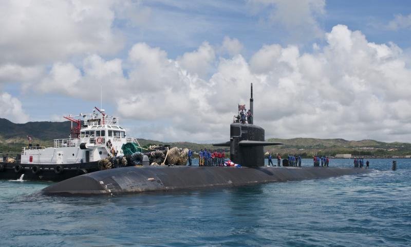 The Los Angeles-class fast-attack submarine USS Chicago arrives at Naval Base Guam after completing a change of homeport from Pearl Harbor, Hawaii, in this April 2012 photo. Corey Hensley/U.S. Navy
