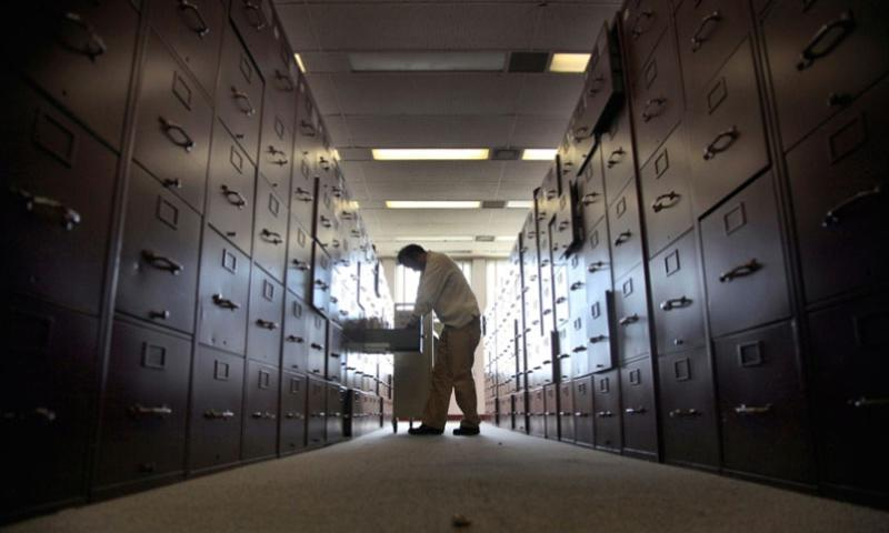 A claims assistant files veterans cases into enormous rows of filing cabinets at the U.S. Department of Veterans Affairs in Los Angeles on December 5, 2012.  Rick Loomis/Los Angeles Times/MCT