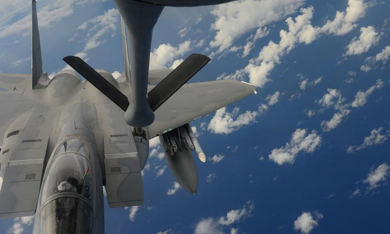 ANDERSEN AIR FORCE BASE, Guam (Sept. 19, 2014) - An F-15 Eagle from the U.S. Air Force 44th Fighter Squadron refuels with a KC-135 Stratotanker from the Air Force 909th Refueling Squadron, while conducting joint air operations during Valiant Shield 2014.  (U.S. Navy photo by Mass Communication Specialist 1st Class (SW) Carla Burdt)