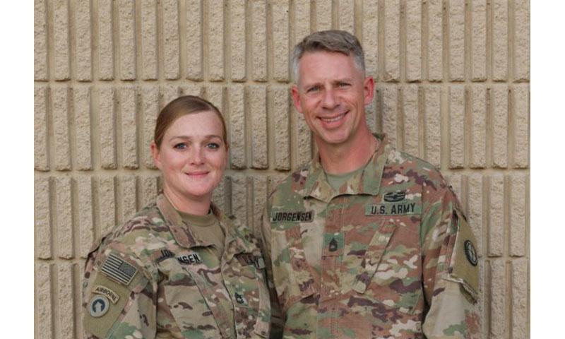 Amy and Robert Jorgensen, Sgts. 1st Class, 35th Inf. Div. pause to reflect on their military service together in support of Operations Inherent Resolve and Spartan Shield, and the importance of Veteran's Day. (Photo Credit: Staff Sgt. Tina Villalobos)