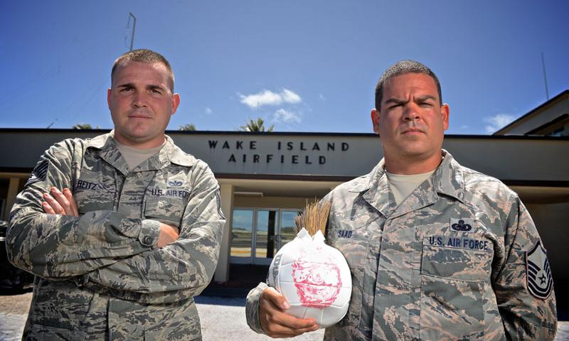 Tech. Sgt. Joshua Reitz, left, and Master Sgt. Yusef Saad, both contracting representatives with Detachment 1, PACAF Regional Support Center, stand in front of the passenger terminal at Wake Island Airfield, July 21, 2015. A small team with four Airmen of Det. 1 supervises contractor operations and ensures mission success on the remote atoll in the Pacific. (U.S. Air Force photo by Staff Sgt. Alexander W. Riedel)