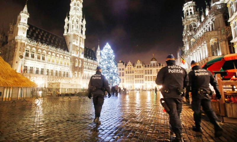 Belgian police officers patrol the Grand Place in downtown Brussels, Belgium, Monday, Nov. 23, 2015. The Belgian capital Brussels has entered its third day of lockdown, with schools and underground transport shut and more than 1,000 security personnel deployed across the country.    Michael Probst/AP Photo