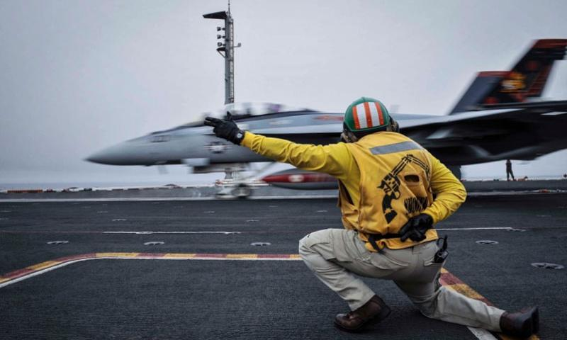 A shooter launches an F/A-18F Super Hornet, assigned to the Red Rippers of Strike Fighter Attack Squadron 11, off the flight deck aboard aircraft carrier USS Theodore Roosevelt on April 15, 2015.    Anna Van Nuys/U.S. Navy