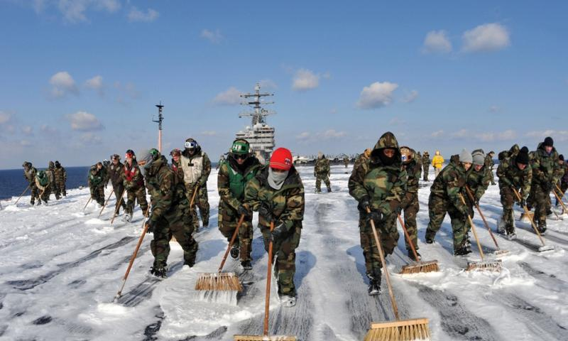 Sailors on the USS Ronald Reagan scrub the aircraft carrier's deck to remove potential radiation contamination during Operation Tomodachi, the humanitarian response to the earthquake and tsunami that ravaged northeast Japan and caused a nuclear meltdown at Fukushima in March 2011.  Nicholas A. Groesch/U.S. Navy