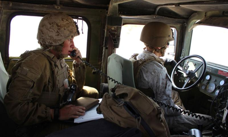Capt. Megan Selbach-Allen, communications officer for 1st Tank Battalion, does a radio check during Exercise Desert Scimitar at Twentynine Palms, Calif., in April 2015. Selbach-Allen was 1 of the 1st women to be assigned to 3rd Combat Engineer Battalion and to 1st Tank Battalion but said her gender has been a nonissue in both units.  Jennifer Hlad/Stars and Stripes