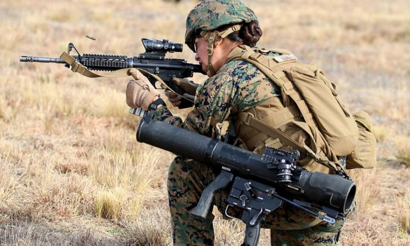 Sgt. Debra C. Riddle engages targets with the M4 Modular Weapon System during a squad supported attack at Range G6 aboard Marine Corps Base Camp Lejeune, N.C., on Feb. 4, 2015.    Alicia R. Leaders/U.S. Marine Corps