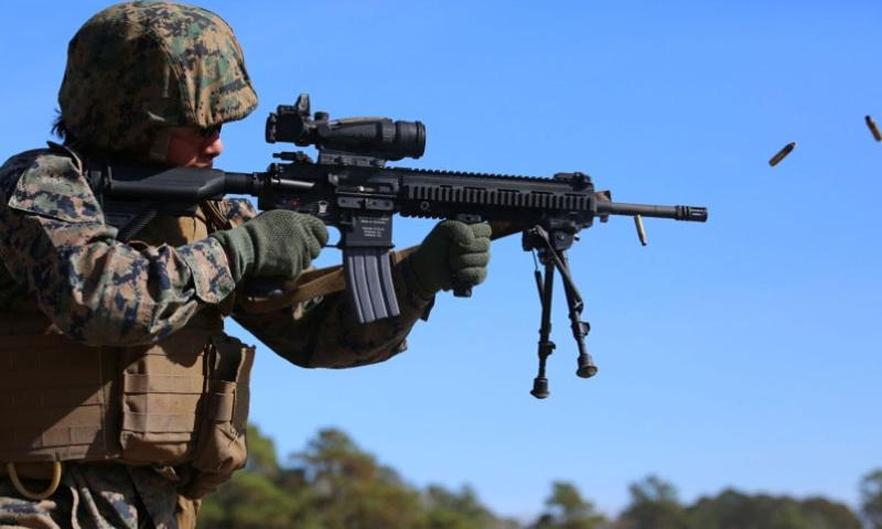 Sgt. Margarita B. Valenzuela, automatic rifleman with 2nd Platoon, Company A, Ground Combat Element Integrated Task Force, engages known-distance targets with the M27 Infantry Automatic Rifle from the standing position during a three-day field exercise at the Verona Loop training area on Marine Corps Base Camp Lejeune, North Carolina, Dec. 3, 2014.    Alicia R. Leaders/U.S. Marine Corps photo