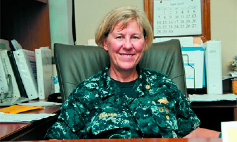Capt. Cheryl Hansen, Naval Facilities Engineering Command Marianas executive officer, is ready to tackle the day ahead at her office in Asan March 19. Hansen encouraged women to pursue opportunities in engineering and in the military. U.S. Navy photo by Shaina Marie Santos