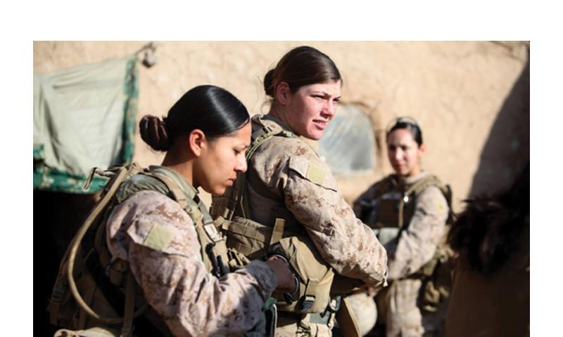 Female Marines assigned to an engagement team speak with a villager in the Helmand province of Afghanistan, Dec. 30, 2010. Marionne Mangrum/U.S. Marine Corps, Flickr