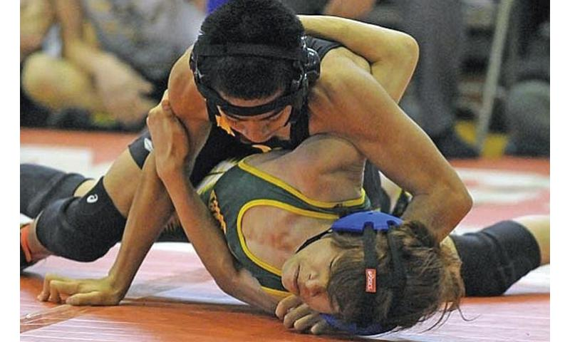 Kadena's Justin Duenas, top, defeated Robert D. Edgren's Francis Estacion at 101 pounds during last year's Far East wrestling tournament. Duenas and other wrestlers will participate in a shortened tournament this year. DODDS-Pacific announced cuts to its season-ending tournaments Friday. Dave Ornauer/Stars and Stripes