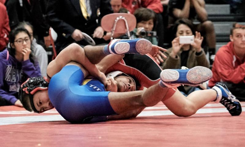 Okozora Hiraoka of Shonan defeats Eshan Singhi of St. Mary's in the Beast of the East 101-pound finals Saturday, Jan. 9, 2016, at Nile C. Kinnick High School in Yokosuka, Japan.    James Kimber/Stars and Stripes