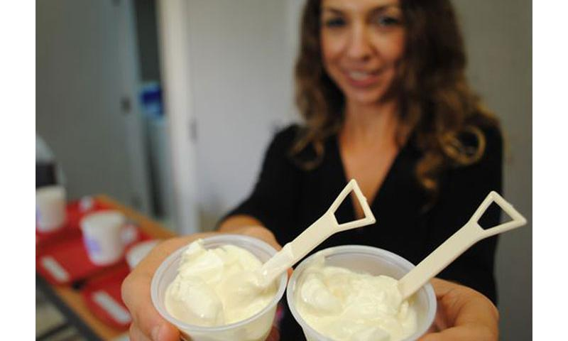 Research associate Stephanie Motroni shows off samples at yje yogurt workshop.