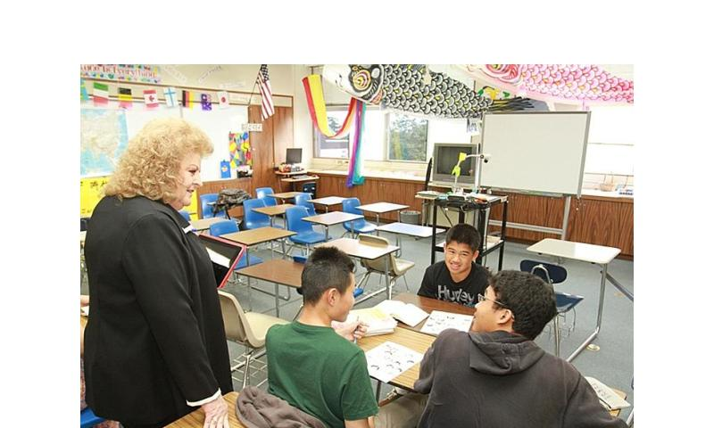 Zama American High School students describe improved teaching practices to Annette Bohling, AdvancED chief accreditation officer, during an accreditation progress review on May 15, 2013.  Courtesy of DODEA