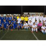 Players called up from the IIAAG Boys High School Soccer League to play in the Guam Football Association Boys High School All-Star Match pose for a group photo with match referees Michael Lee, Joshua Bamba, and James Oh (all in yellow) Wednesday evening at the GFA National Training Center. Team Gadao (in blue jerseys) defeated Team Hurao (in white jerseys) 5-3. (Photo by Jesse Mesa/GFA)