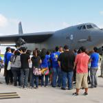 Students and chaperons from the Guam Community College listen as Airman 1st Class Elliot Williams, 36th Expeditionary Aircraft Maintenance Squadron, explains his job as a dedicated B-52 Stratofortress crew chief on the flightline (U.S. Air Force photo/Airman 1st Class Marianique Santos/Released)