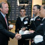 Neil Bush, left, son of former President George H.W. Bush and chairman of the board for Points of Light, greets Boatswain's Mate Seaman Lakenya Simpson during the Community Blueprint Luncheon at the Chamber of Commerce in Washington, D.C. (U.S. Navy photo by Mass Communication Specialist 2nd Class Timothy Walter/Released)