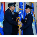 """Air Force Chief of Staff Gen. Norton Schwartz presents the Pacific Air Forces flag to new PACAF commander Gen. Herbert """"Hawk"""" Carlisle, signifying the transfer of command at Joint Base Pearl Harbor-Hickam, Hawaii, Aug. 3, 2012. Carlisle is the successor to Gen. Gary North, who took command of Pacific Air Forces in August 2009. (U.S. Air Force photo/Tech. Sgt. Jerome S. Tayborn)"""