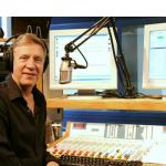 George Smith, 58, posing here in a radio studio at AFN headquarters in Mannheim, Germany, is one of thousands of Defense Department employees overseas who could be affected by stricter guidelines recently issued by DOD making it much more difficult for civilians to extend their overseas tours past five or seven years. Smith has worked in Europe for more than 25 years and currently oversees eight AFN stations in Europe. Michael Abrams/Stars and Stripes
