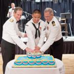 Hospitalman David Wong, of U.S. Naval Hospital (USNH) Guam, the youngest Sailor, center, and Cmdr. Harold Zald, of USS Frank Cable (AS 40), the most experienced Sailor, right, cut the cake with Rear Adm. Tilghman D. Payne, Commander, Joint Region Marianas, during the Navy Ball at the Hyatt Regency Guam in Tumon Oct. 13. Enlisted Sailors, officers and guests honored the Navy's birthday by celebrating 237 years of naval tradition. U.S. Navy photo by Mass Communication Specialist 2nd Class Corwin Colbert