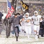 Black Knight football players charge onto the field for the 118th Army-Navy Game in Philadelphia. (Photo Credit: DoD photo by EJ Hersom)