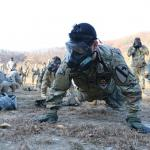 A soldier assigned to 3rd Battalion, 16th Field Artillery Regiment, conducts pushup drills during chemical, biological, radiological and nuclear training at Camp Casey, South Korea, Nov. 9, 2017. Soldiers conducted the exercise to maintain a high state of readiness and to be able instantly react against CBRN attacks. Army photo by Pfc. Hyeonmin Lee