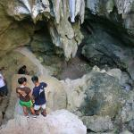 Local hikers enter one of the Talofofo Caves to explore and study artifacts such as lusongs, stone mortars, and pictographs, left by ancient Chamorros. Photo by Nathalie Pereda, courtesy of Guampedia